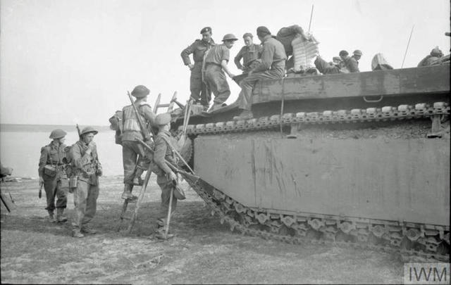 Royal Engineers climb into a Buffalo for the crossing of the Rhine 24 March 1945