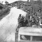Fred Stock and Walter Marshall and others outside a village near Kumming.